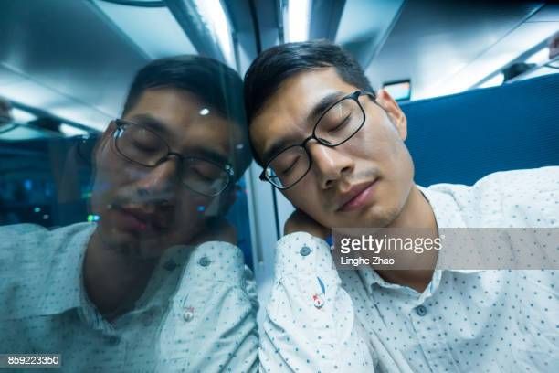Man sleep on train at night