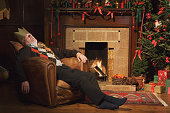 Man sleeping by fireplace