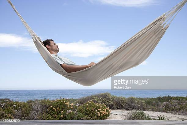 Man sleeping in a hammock