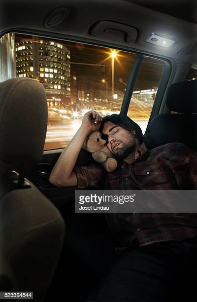 Man sleeping in back seat of SUV