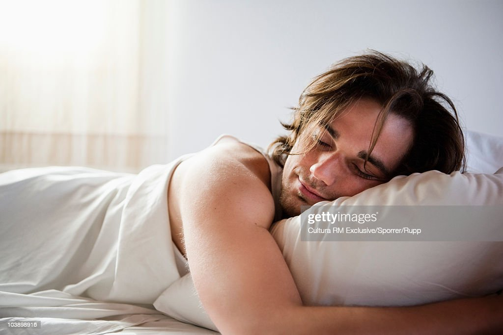 Man sleeping in bed : Stock Photo