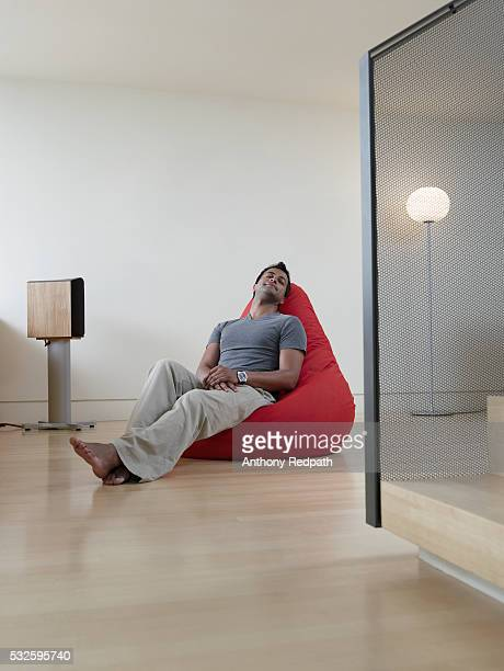 Man sleeping in chair