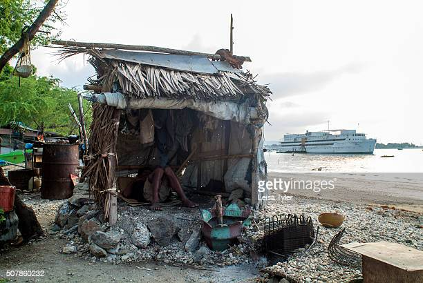 A man sleeping in his hut in a shanty town on the beach in Dili East Timor