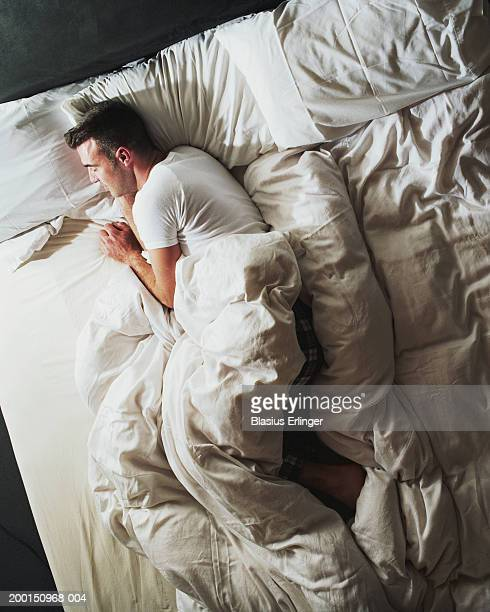 Man sleeping on bed, elevated view