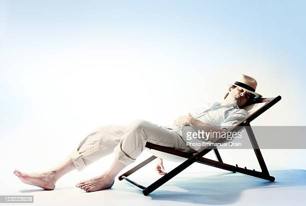 Man sleeping on resting chair