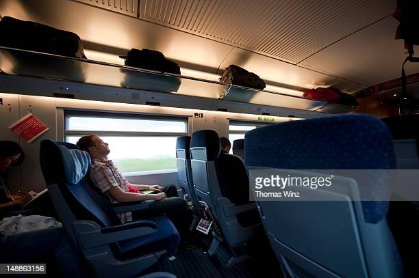 Man sleeping on train.