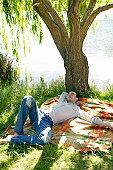 Man sleeping under a tree