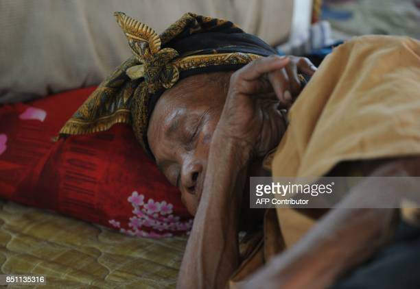 A man sleeps after being evacuated during the raised alert levels for the volcano on Mount Agung in Klungkung regency on the Indonesian resort island...
