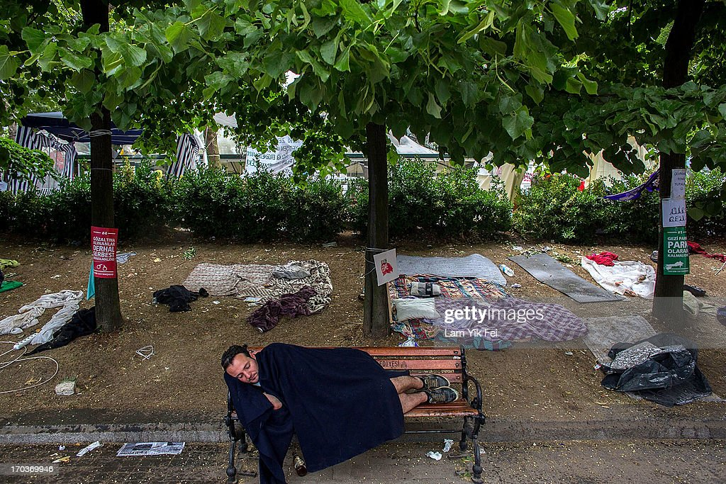 A man sleeps on a chair in Gezi Park the morning after a police crackdown on protesters, on June 12, 2013 in Istanbul, Turkey. Istanbul has seen protests rage on for days, with two protesters and one police officer killed. What began as a protest over the fate of Taksim Gezi Park, has turned into a wider demonstration over Prime Minister Recep Tayyip Erdogan's policies.