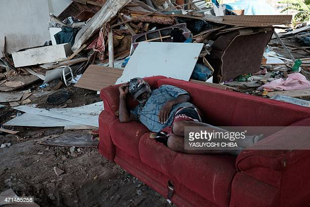 A man sleeps on a sofa after his shanty was demolished following an order from the city hall to demolish about 40 shacks under a flyover in Rio de...