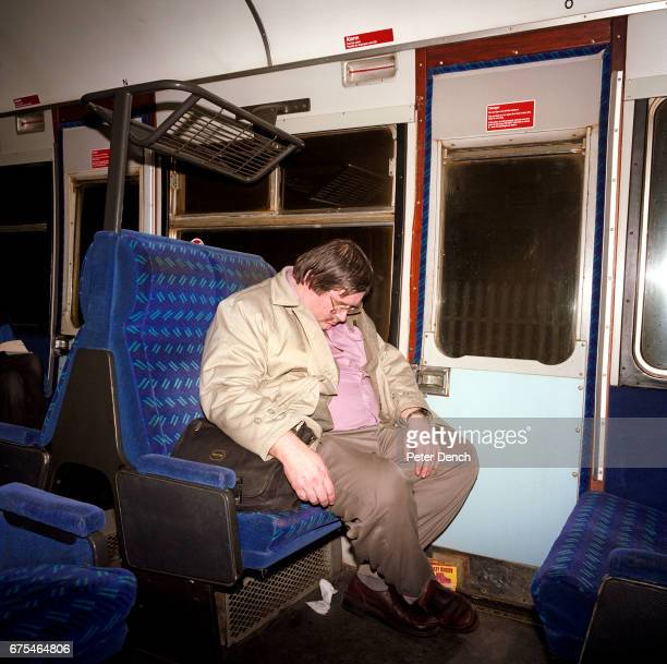 A man sleeps on a train after a visit to the White Cliffs Festival of Winter Ales in Dover February 2001