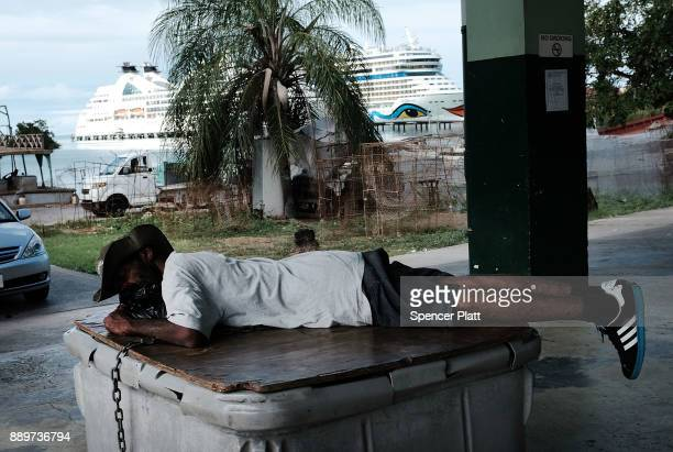 A man sleeps on a trolley on December 10 2017 in St John's Antiqua While it's sister island Barbuda was nearly destroyed in Hurricane Irma Antiqua...