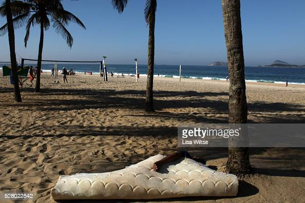 JULY 9 2010 A man sleeps on an old mattress in the early morning on Ipanema beach in Rio de Janeiro July 9 2010 Photo by Lisa Wiltse