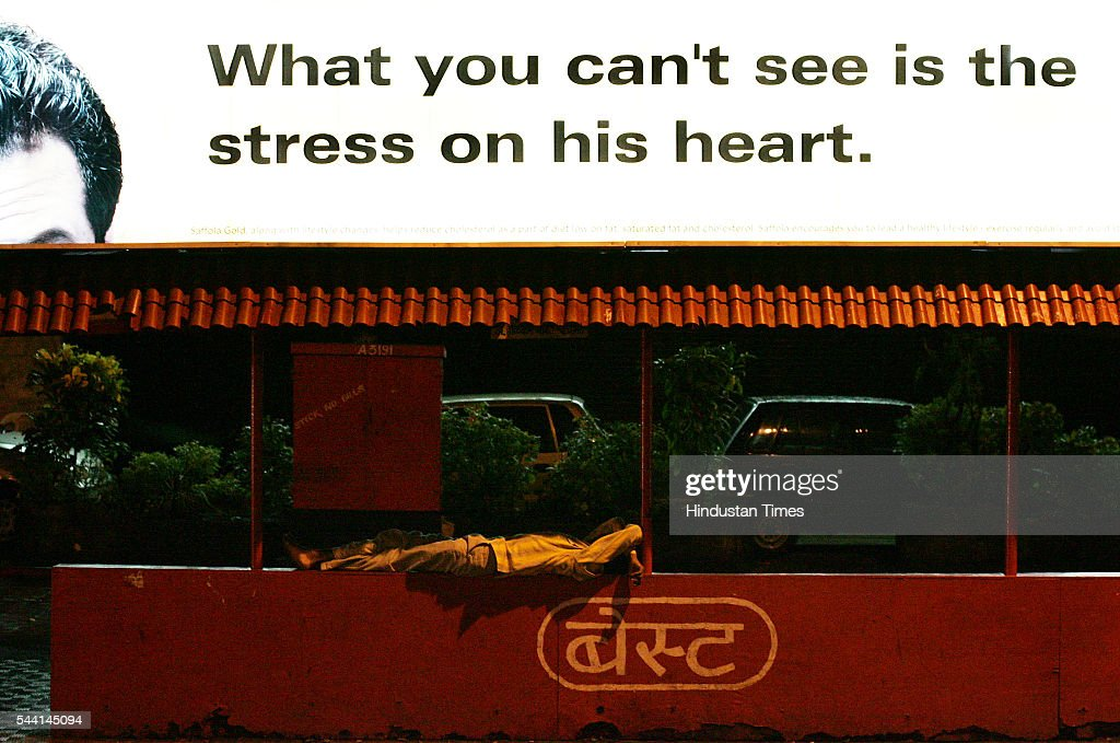 A man sleeps on the bus stop at 1 in morning at churchgate.