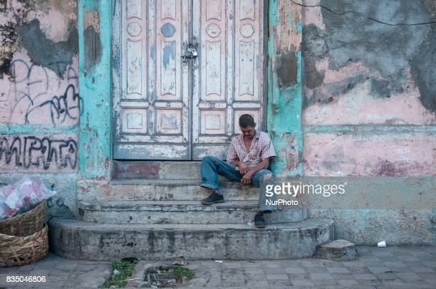 A man sleeps on the steps of a colonial building in Granada Nicaragua on 23 October 2011