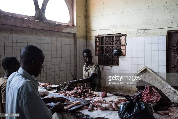 A man slices fish to be sold at a market on October 13 2016 in Mogadishu Somalia Somalia is on the brink of its first parliamentary elections since...