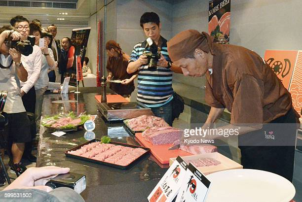 KONG A man slices Kobe beef during an event in Hong Kong on July 25 2012 Kobe beef a tender richtasting meat that used to be sold only in Japan is...