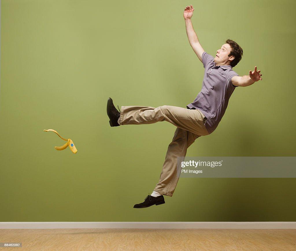 Man slipping on banana peel : Stock Photo