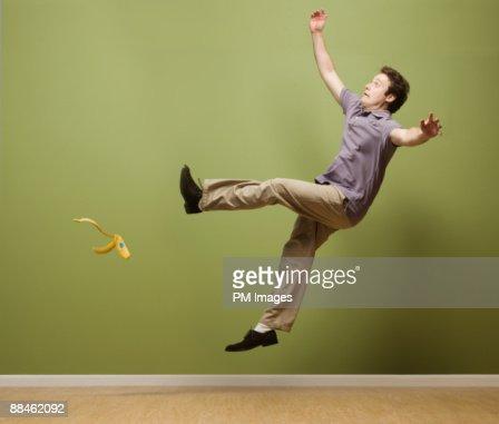 Man slipping on banana peel