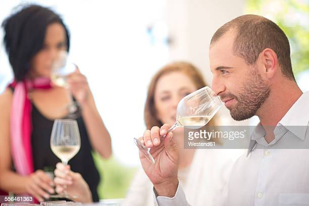 Man smelling white wine on a wine tasting session