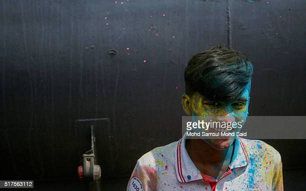 A man smile as his face covered in coloured powder during Holi festivals at a temple on March 26 2016 in Kuala Lumpur Malaysia Holi also known as the...