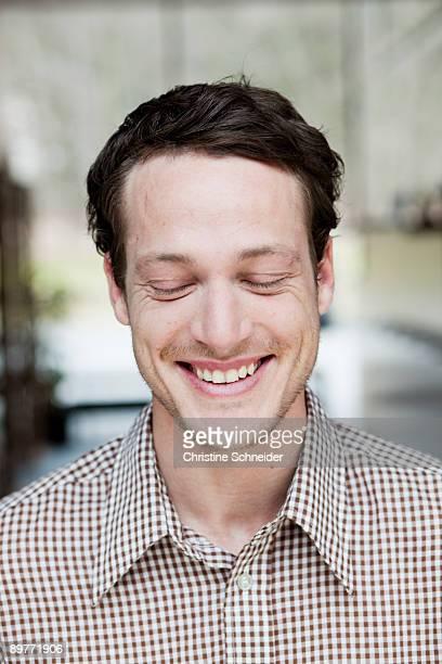 man smiling eyes closed