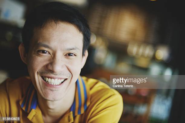Man smiling in a cafe