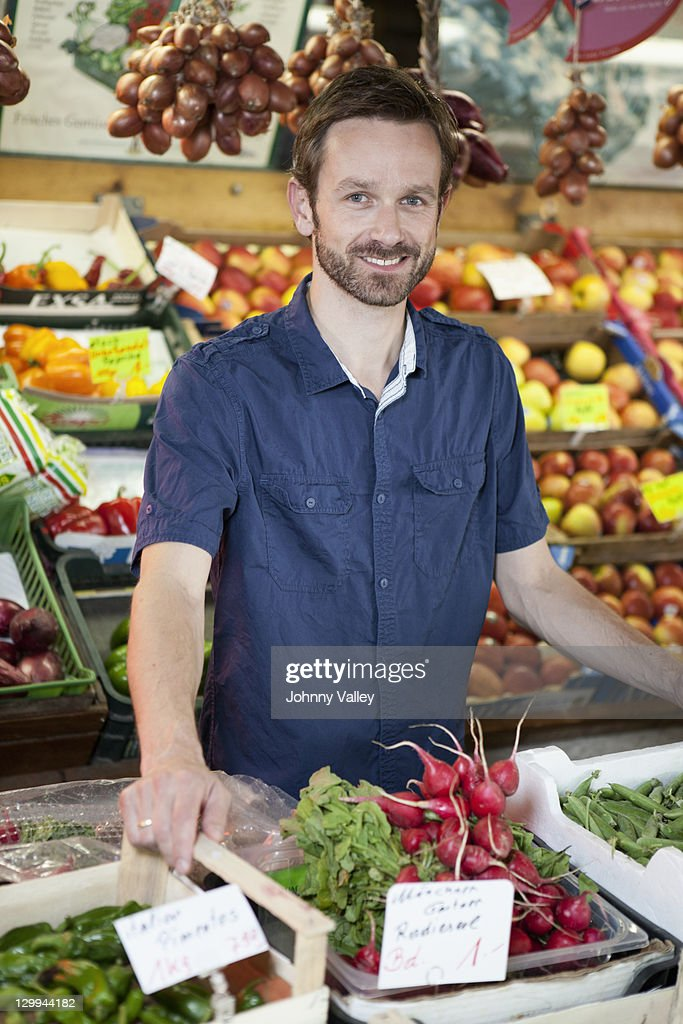 Man smiling in produce stand