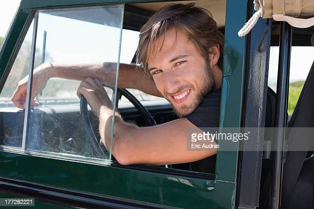 Man smiling in SUV