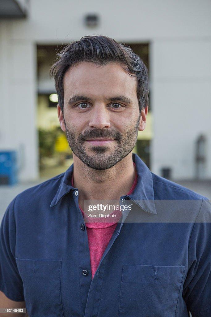 Man smiling outdoors : Stock Photo
