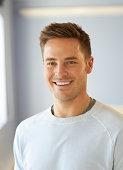 Man smiling, portrait.