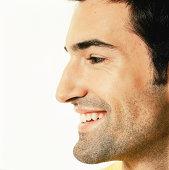 Man smiling, profile, close up