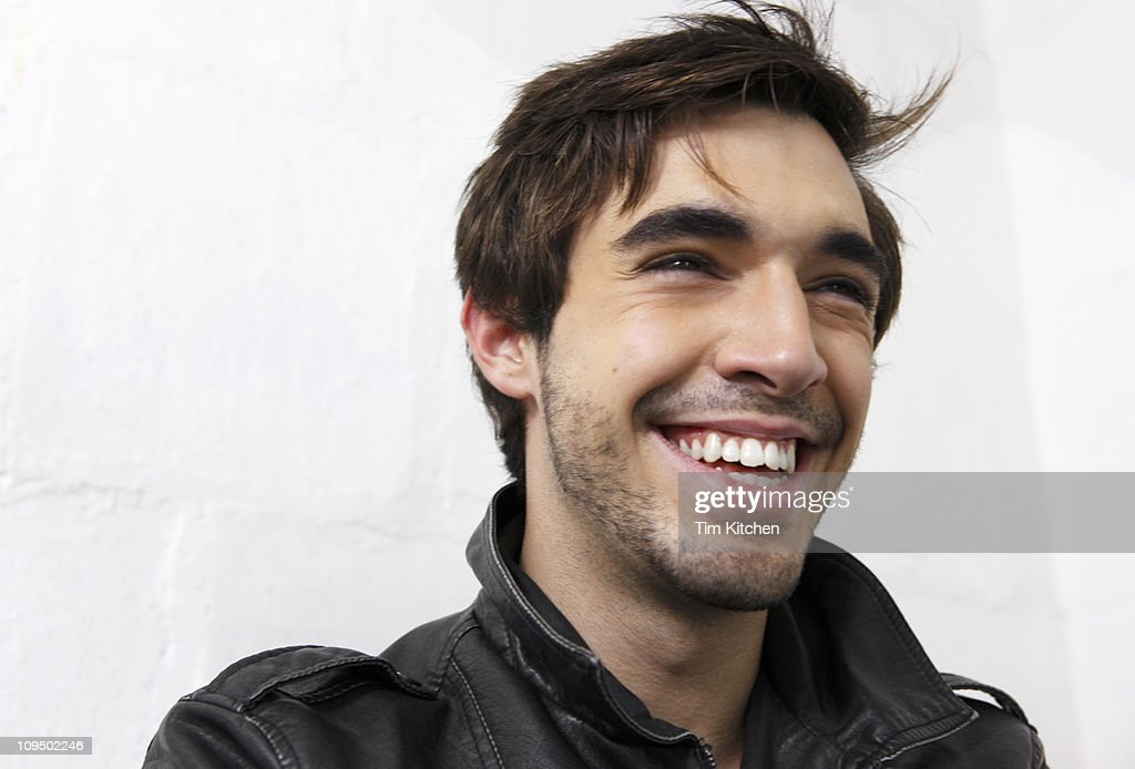 Man smiling, wearing leather jacket, portrait : Stock Photo