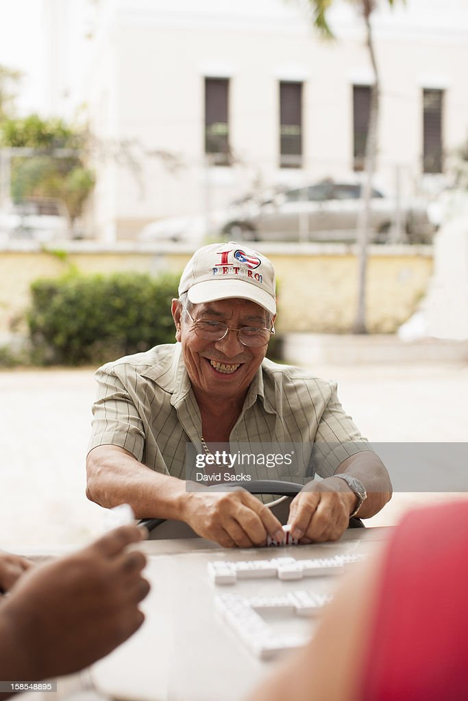 Man smiling with dominos : Stock Photo