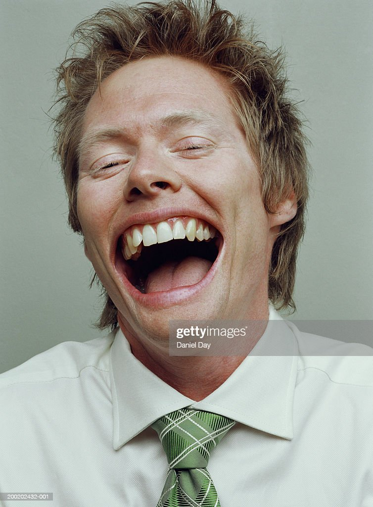 Man smiling with mouth held wide open (Digital Enhancement) : Stock Photo