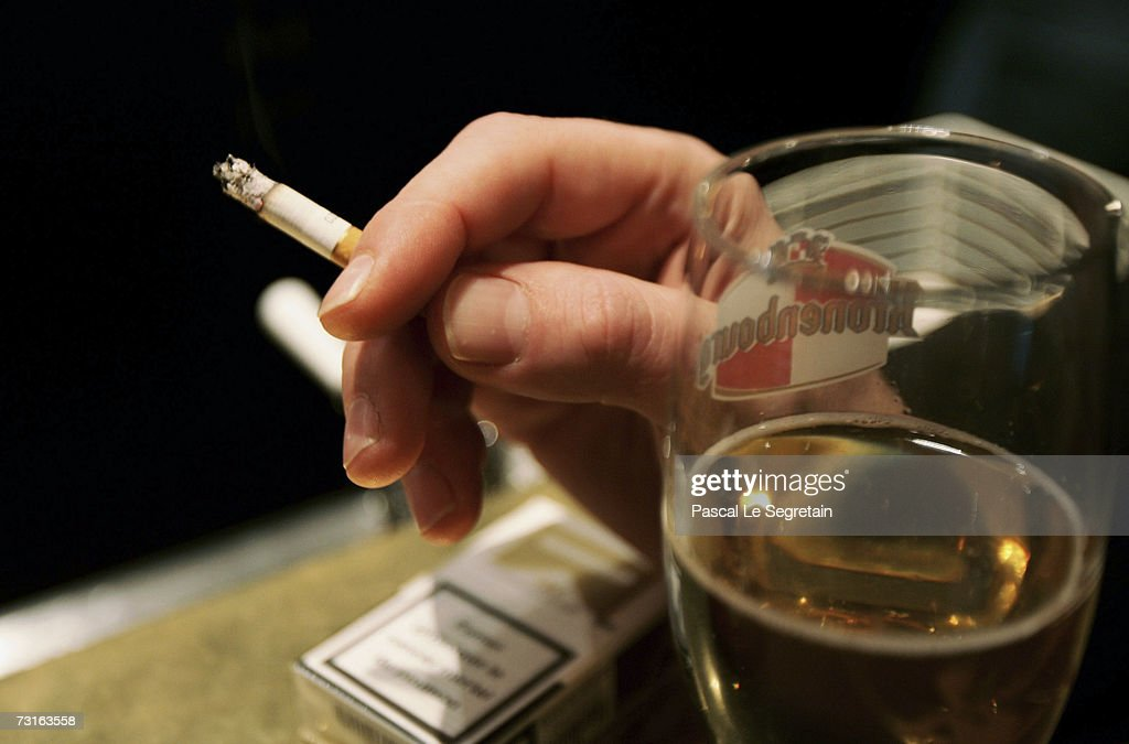 A man smokes a cigarette in a bar on January 31, 2007 in Paris, France. France will introduce a smoking ban in public places February 1, 2007 and bars, restaurants, hotels and night clubs will follow on January 1, 2008.