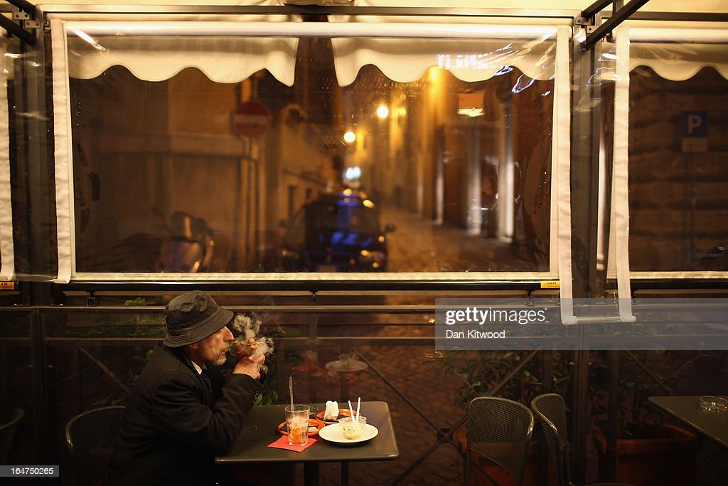 A man smokes a cigarette in a cafe on March 27, 2013 in Rome, Italy.