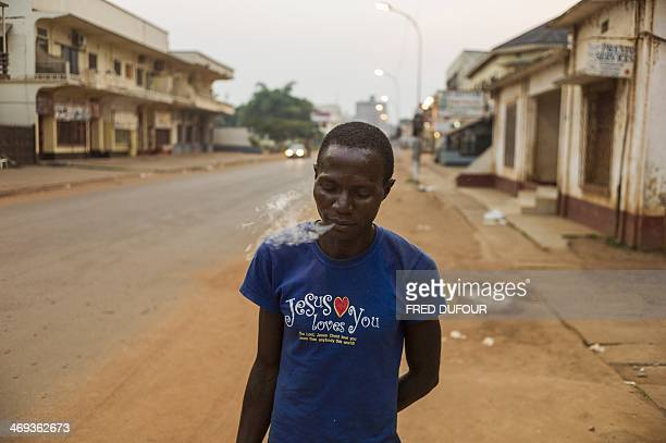A man smokes a cigarette in a street in Bangui Central African Republic on February 14 2014 France said today it was sending 400 more troops to the...