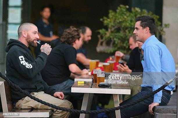 A man smokes a cigarette in an outdoor pub in the central business district on May 15 2014 in Melbourne Australia Following a successful smoking ban...