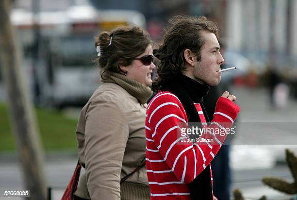 A man smokes a cigarette near Pier 39 January 26 2005 in San Francisco California San Francisco Board of Supervisors voted January 25 to ban smoking...