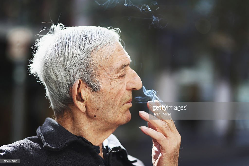 A man smokes a cigarette on May 04, 2016 in Sydney, New South Wales.The Australian Government yesterday announced in their budget four annual 12.5 per cent increases to tobacco excise and excise equivalent customs duties which will significantly push up the over-the counter price up to AUD$40 by 2020.