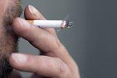A man smokes a cigarette on May 9 2015 in Paris AFP PHOTO / KENZO TRIBOUILLARD