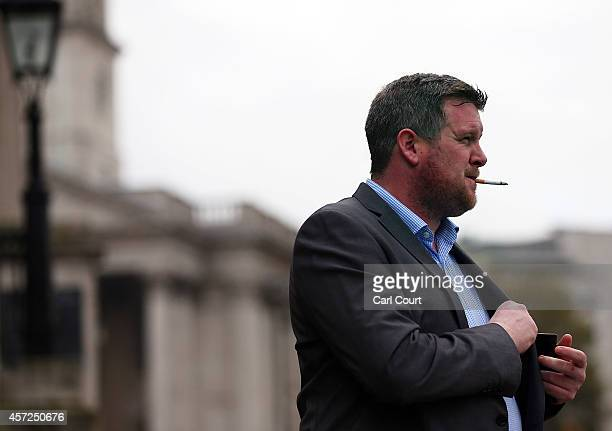 A man smokes a cigarette on October 15 in Trafalgar Square in London England Following a report called 'Better Health for London' put together by...