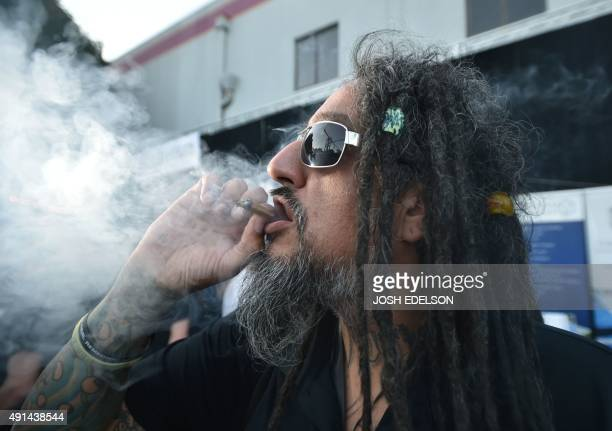A man smokes a joint at the first annual DOPE Cup a cannabis competition in Portland Oregon on October 4 2015 As of October 1 2015 limited amounts of...
