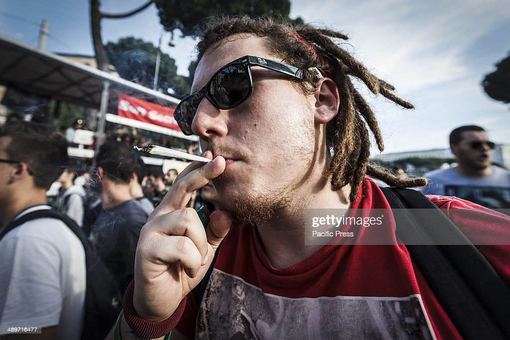 A man smokes a joint during the Global Marijuana March in Rome to ask for the legalization of marijuana on Saturday, May 10, 2014. Thousands of people marched downtown in Rome during the Global Marijuana March, an annual rally held at different locations across the planet, demanding the legalization of marijuana and changes in drug policies. The Global Marijuana March (GMM) also goes by the name of the Worldwide Marijuana March (WMM) or Million Marijuana March (MMM).
