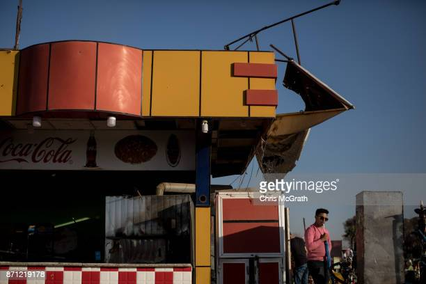 A man smokes a Shisha at the Mosul Amusement Park on November 4 2017 in Mosul Iraq The theme park was shut down under ISIS occupation and the grounds...
