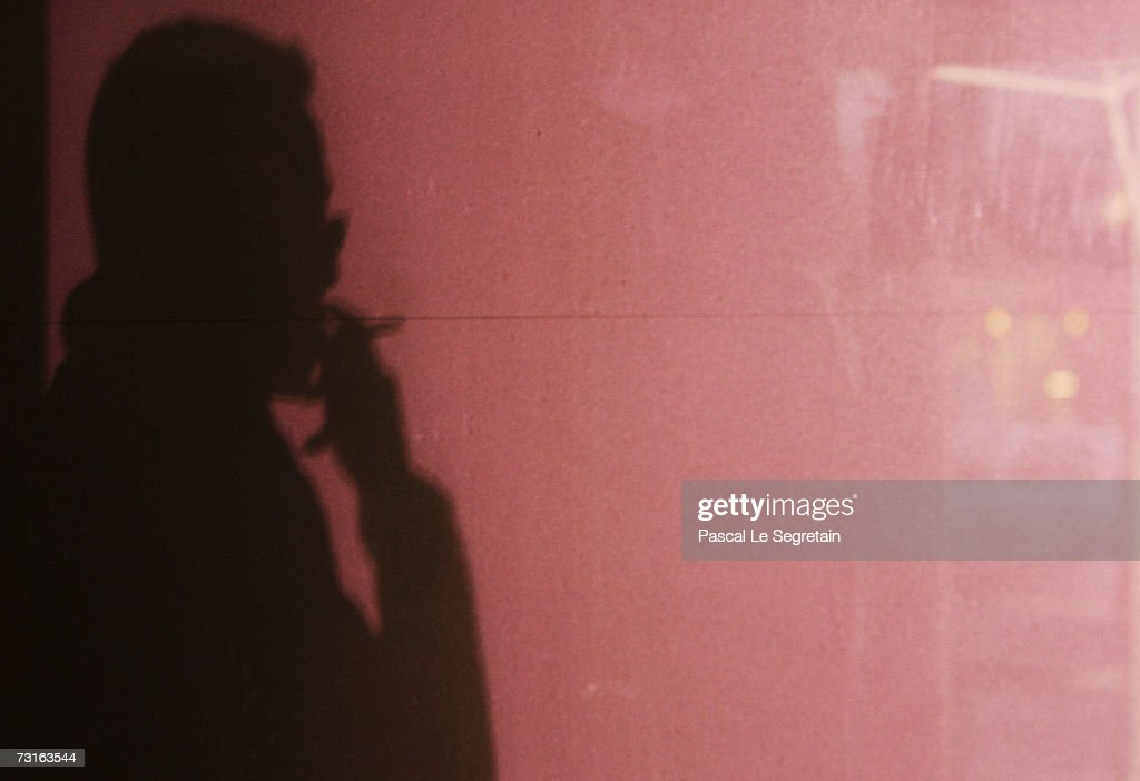 A man smokes cigarettes in the street outside a office on January 31, 2007 in Paris, France. France will introduce a smoking ban in public places February 1, 2007 and bars, restaurants, hotels and night clubs will follow on January 1, 2008.