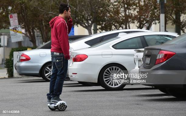 A man smokes his cigarette while riding his hoverboard in Venice BeachCalifornia on December 10 2015 The hot item on many holiday lists will help you...