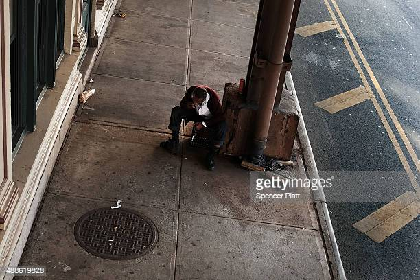 A man smokes K2 in an area which has witnessed an explosion in the use of K2 or 'Spice' a synthetic marijuana drug in East Harlem on September 16...