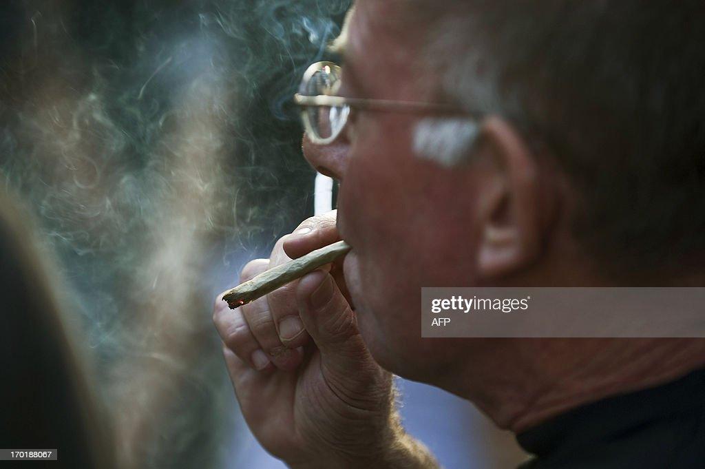 A man smokes marijuana during a march demanding its legalization on June 8, 2013, in Sao Paulo, Brazil.